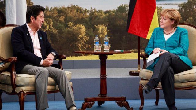 Shinzo Abe y Angela Merkel