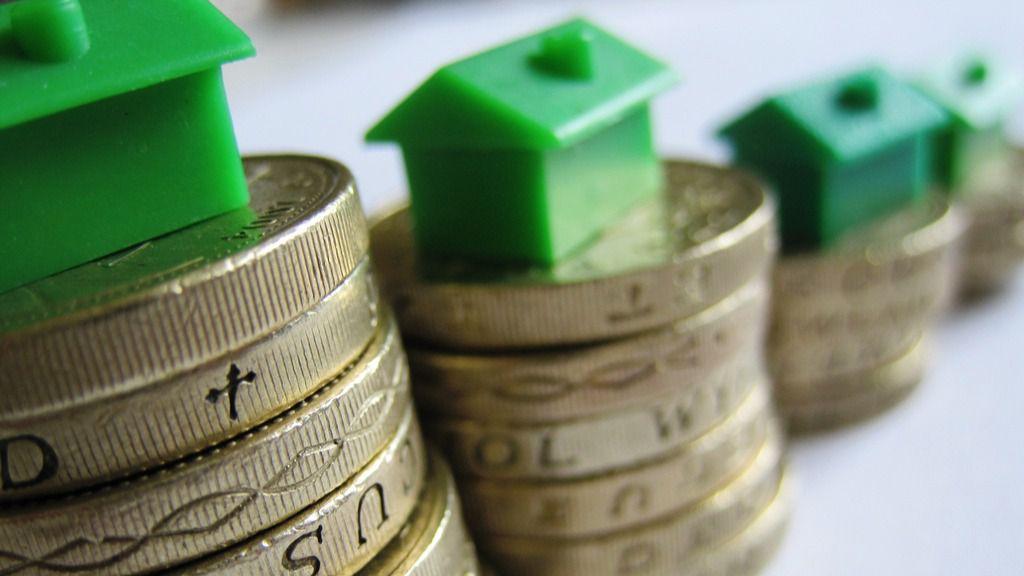 Monedas casas viviendas hipotecas