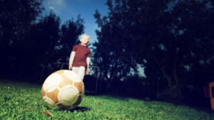 nino futbol juego