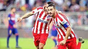Koke y Correa celebran el primer gol del Atlético ante el Barça