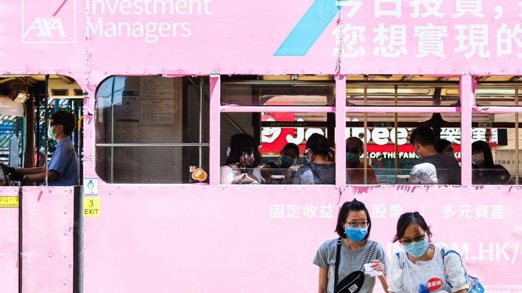 Personas con mascarilla en Hong Kong