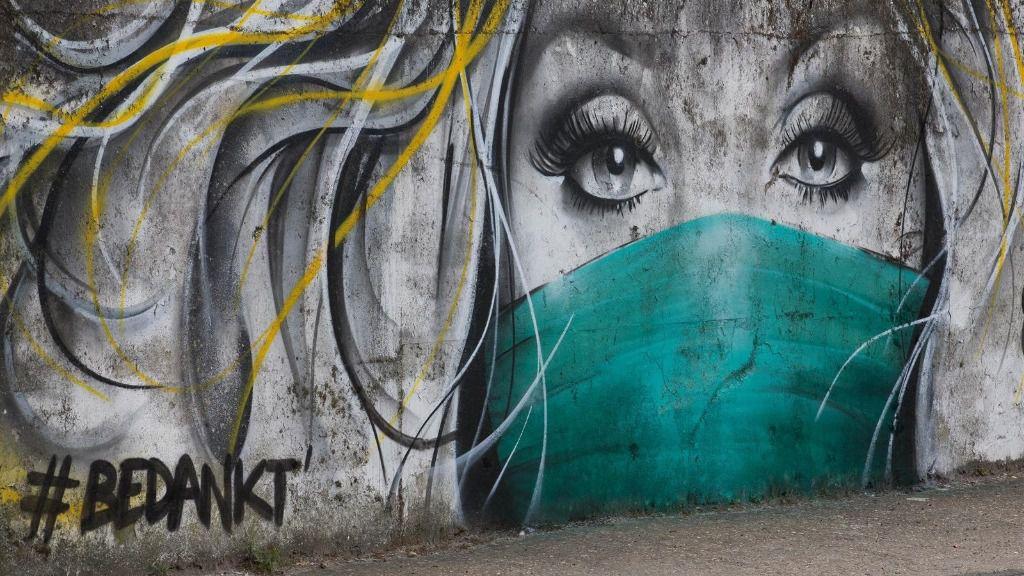 Un graffitti en una ciudad de Bélgica coronavirus