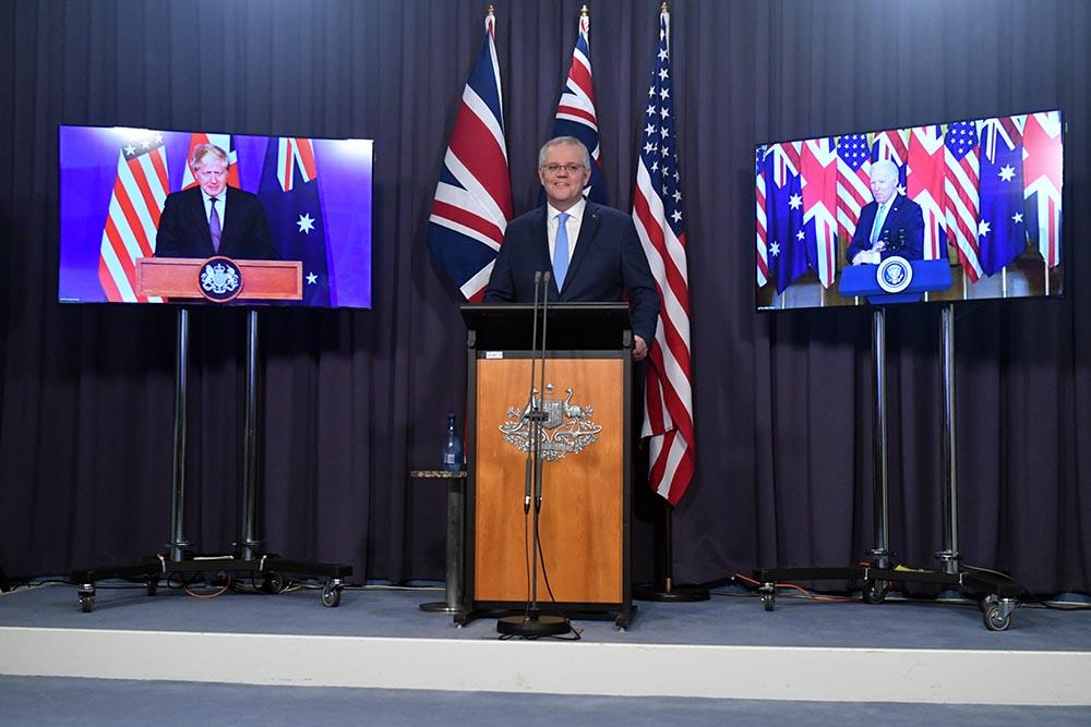 El primer ministro birtánico, Boris Johnson, su homólogo australiano, Scott Morrison, y el presidente de Estados Unidos, Joe Biden, durante la presentación del acuerdo trilateral AUKUS - AAPIMAGE / DPA